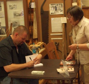 "Signing ""Sky Pilot of the Great Lakes"""